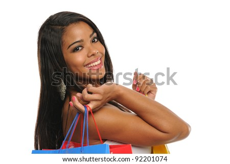 Young Black Woman Holding shopping bags and smiling isolated on a white background - stock photo