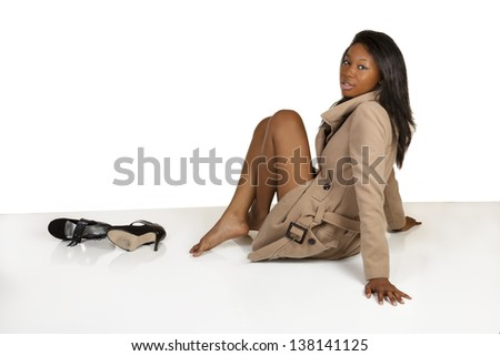 Young Black Woman Jacket Heels On Floor
