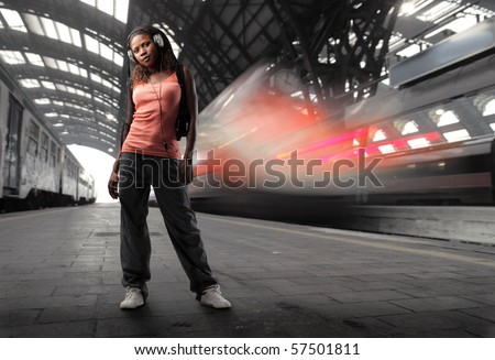young black woman listen music in a station - stock photo