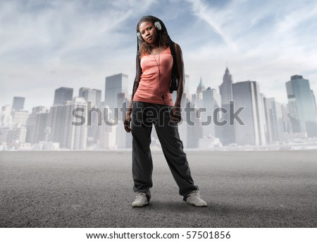 young black woman listen music in the city - stock photo