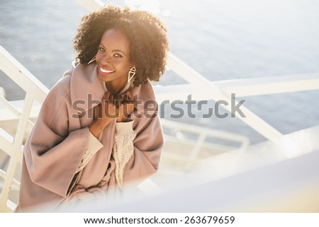 Young black woman on the street - stock photo