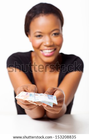 young black woman presenting south african money - stock photo