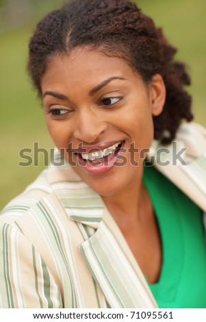 Young black woman smiling - stock photo