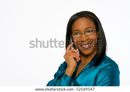 Young black woman smiling and talking on mobile phone. - stock photo