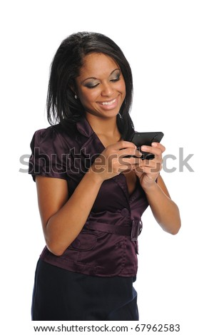 Young Black woman text messaging and smiling isolated on a white background - stock photo