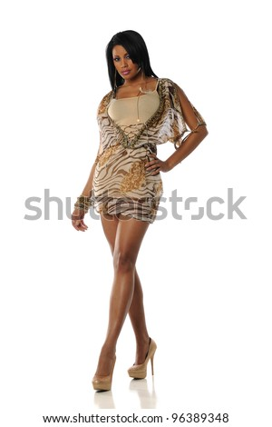 Young Black Woman wearing a fancy dress on a white background - stock photo