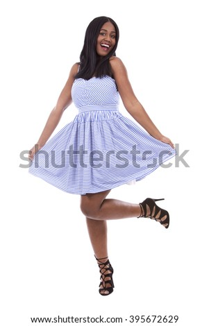 young black woman wearing blue dress on white background - stock photo