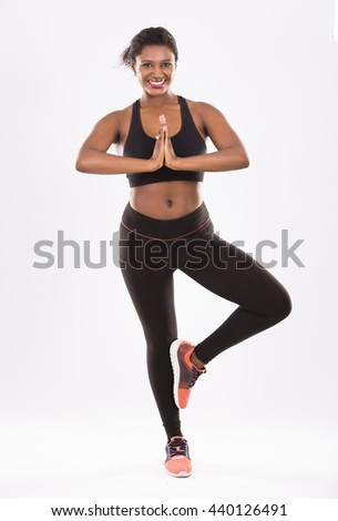 young black woman wearing fitness outfit on white isolated background - stock photo