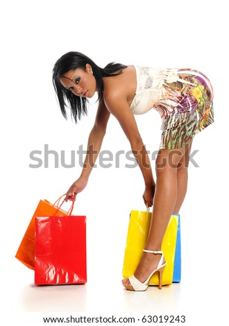 Young Black Woman with colorful shopping bags isolated on a white background