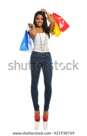 Young black woman with shopping bags isolated on a white background