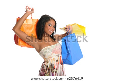 Young Black Woman with shopping bags isolated on a white background - stock photo