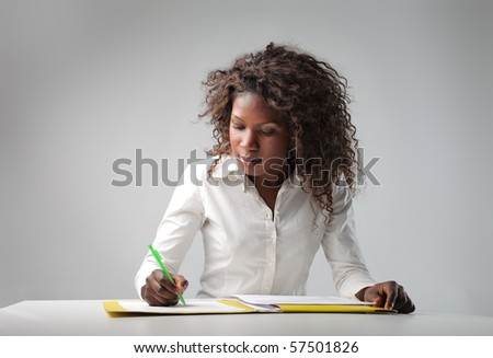 young black woman writing - stock photo
