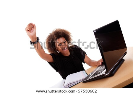 young black women in front of the computer, arm raised and happy, isolated on white background. Studio shot. - stock photo