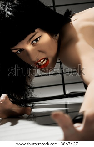 young blackhair woman in rage pose - stock photo