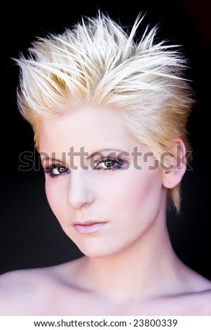 Young blond beauty portrait over black background. - stock photo