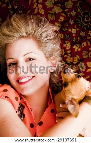 Young blond beauty posing with her pet. - stock photo
