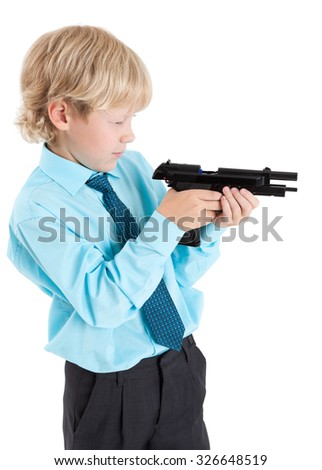 young blond boy looking into the discharged gun in hands, isolated on white background - stock photo