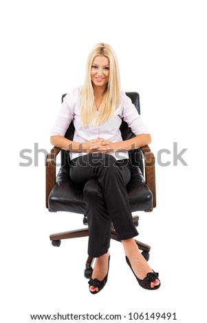 Young blond businesswoman in a chair isolated on white background - stock photo