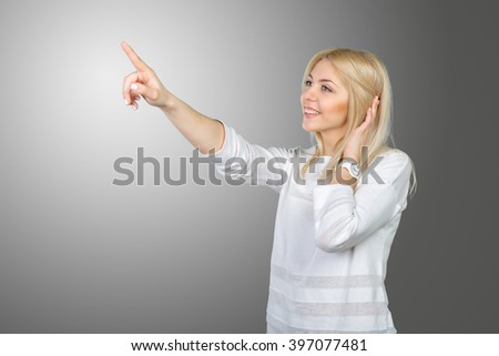 Young blond businesswoman pressing the touchscreen button