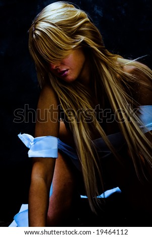 young blond dancer with white strips - stock photo
