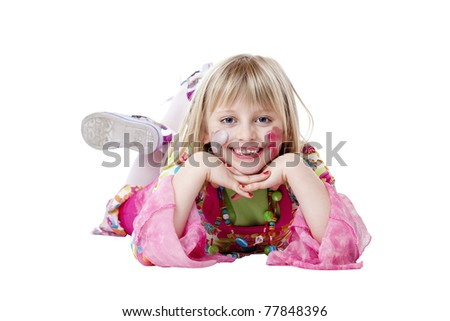 Young blond disguised pretty girls lies on the floor and smiles.Isolated on white background - stock photo