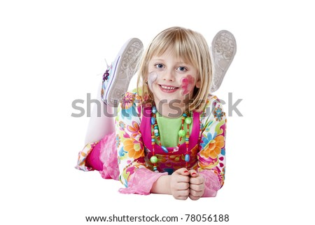 Young blond disguised pretty girls lies on the floor and smiles.Isolated on white background. - stock photo