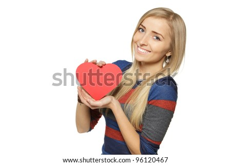 Young blond female holding heart shape isolated on white background - stock photo