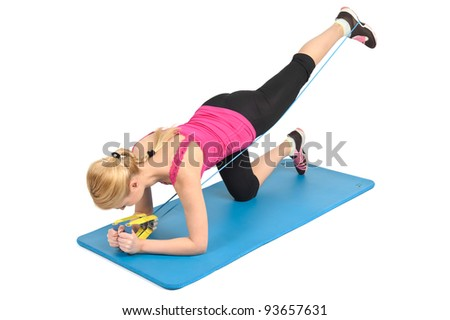Young blond girl doing kneeling butt blaster exercise using rubber resistance band. position 1 of 2. - stock photo