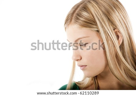 Young blond girl in deep thought - stock photo