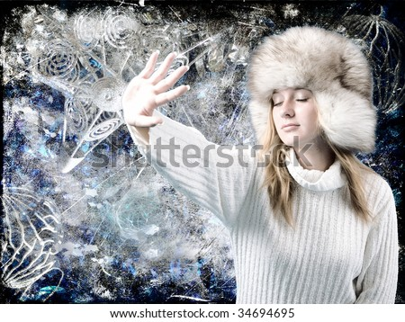 Young blond girl in white sweater and fur hat - stock photo