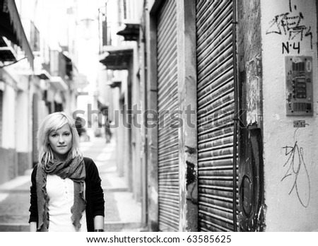 Young blond girl portrait on slum street background - stock photo