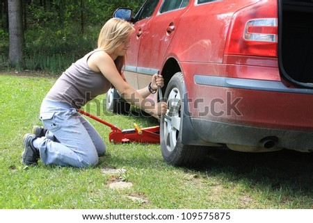 young blond girl puncture repairs - stock photo