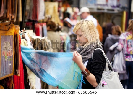 Young blond girl shopping some muslim goods. - stock photo