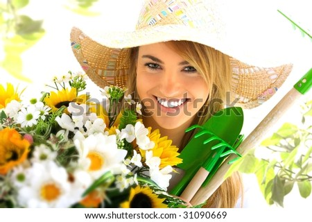 young blond girl with gardening tools - stock photo