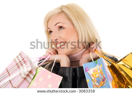 Young blond girl with shopping bags isolated on white