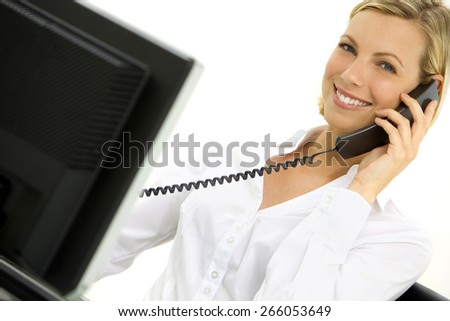 Young blond hair Caucasian Businesswoman on the phone at workplace - stock photo