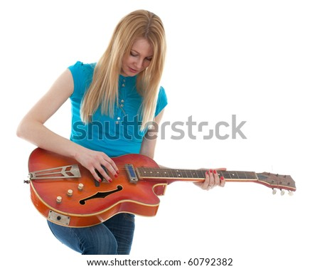 young blond hair woman with electric guitar - stock photo