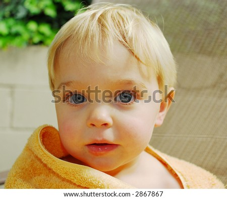 young blond haired boy with towel - stock photo