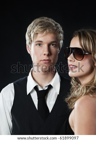 Young blond handsome man and pretty blond woman in sunglasses - stock photo