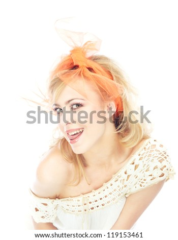 Young blond lady flirting on a white background