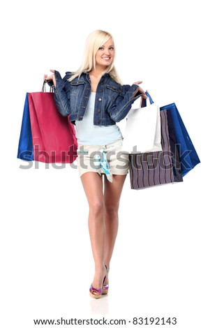 Young blond lady holding shopping bags isolated on white