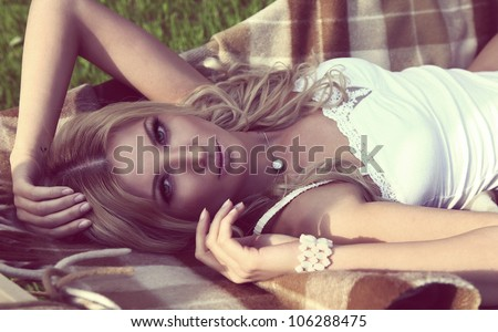 young blond sensual woman lying in the hammock - stock photo