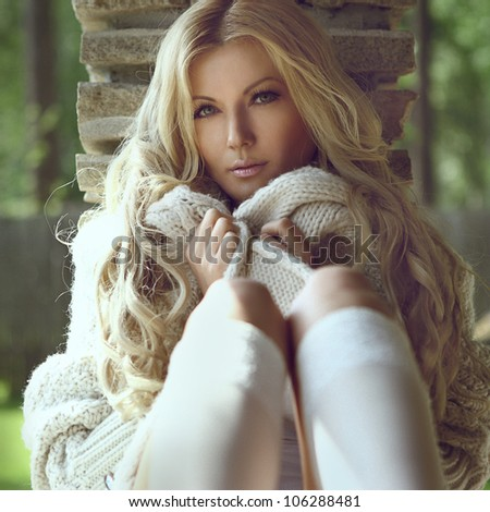 young blond sexual woman with long curly hair - stock photo