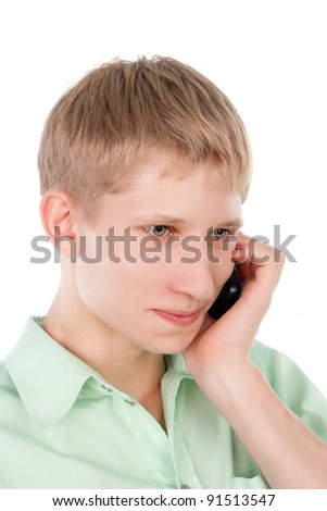 young blond smiling guy speaking the mobile phone - stock photo
