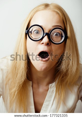 young blond teenage girl in big glasses fool around, having fun student