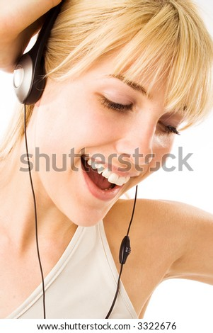 young blond with headphones listening music - stock photo