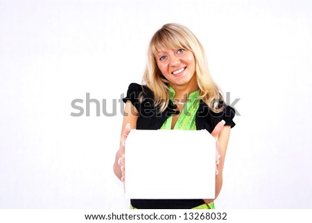 Young blond woman and white box shot in studio.