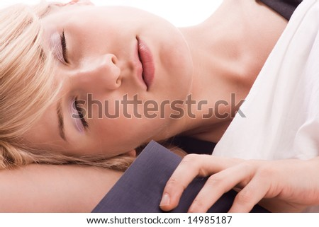 young blond woman asleep with book