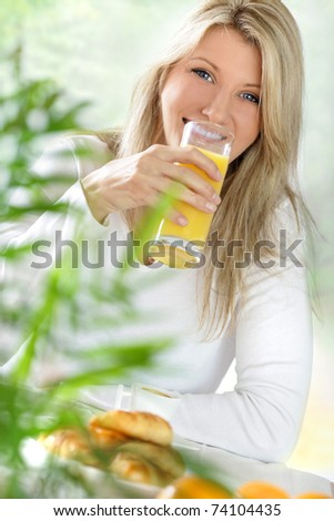 young blond woman at breackfast - stock photo