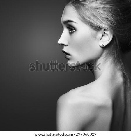 Young blond woman.Beautiful blonde Girl.close-up fashion monochrome portrait - stock photo